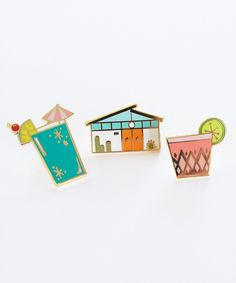 """It's always happy hour with this retro cocktail pin! Inspired by colorful drinks sipped out of mid-century glass barware, pin it to your favorite jacket, hat, backpack, beach bag, etc.! - 1"""" tall (hard enamel) pin - Polished gold metal - rubber backing - Illustrated by Katie Thierjung"""