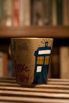 """Doctor Who """"Oi, Watch it, Spaceman"""" Donna and Tenth Doctor Quote Mug with TARDIS - Large, brown mug. $17.00, via Etsy."""