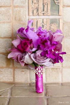 Purple roses and orchids bouquet