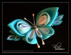 Butterflies seem to be the easiest thing to make when you have just a few leftover petals from a kanzashi project.