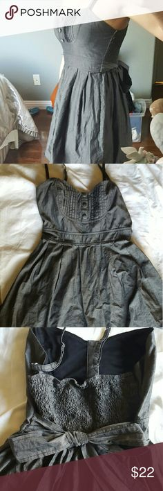 Cute grey spaghetti strap Lola dress Perfect for any occasion and in great condition. Adorable tie up bow in the back and a very flattering waistline and top. True to size. lola Dresses