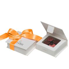 Confetti chocolate wedding favors - Orange $6 On your special day, you wish everything to be perfect, so that not only you but all of your guests cherish the memory of the magical occasion they shared with you. Original yet timeless, sweet yet delicate, these Petit Richart are the perfect attention for your guests. Whether your wedding is in July or December, these assorted chocolates will delight all with their lovely customizable box and ribbon and… #wedding #favors #chocolate #ganache