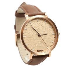 The Tmbr Helm Minimalist Wood Watch made with brushed Rose Gold and Cherry Wood dial. The 40mm unisex gold wood watch comes with a genuine leather strap and free shipping in the USA.