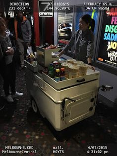 Movable snack cart pushed outside cinema entrance after end of movie max profits   .HOYTS Entertainment Melbourne Movies Snacks