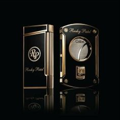 Rocky Patel Black and Gold Limited Edition Colbri Lighter and Cutter by Colbri. $149.95. Limited production of 1000. Dual soft flame and torch lighter. Manufactured by Colibri. Fuel window and flame adjustment. Black lacquer with 18 karat gold accents. Two names that are synonymous with quality, Rocky Patel and Colbri. They have teamed up to produce a collectors item that even the most novice cigar smoker would envy. The Rocky Patel Limited Edition Black and Gold Deca...