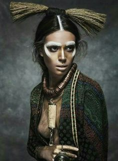 Shot by Jesus Alonso....Love it!! #fashion #photography #Elle #Romania #dark #colors #face #paint #decorated #cool #beautiful #headpiece #creative #chic #amazing #thinkoutsidethebox #WeLove #Loveit #gorgeous #neckpiece WWW.AFROSTYLEMAG.COM