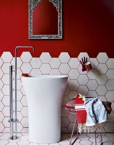 A Grout of a Different Color – Reveal Studio. Color grout is trending, and we are showing you different ways to incorporate it into your home. Red grout and hexagon tiles match the red walls in this powder room. Tile Design Pictures, Red Interior Design, Coloured Grout, Room Wall Colors, Bathroom Red, Bathroom Wall, Bathroom Storage, Small Bathroom, Bathroom Ideas