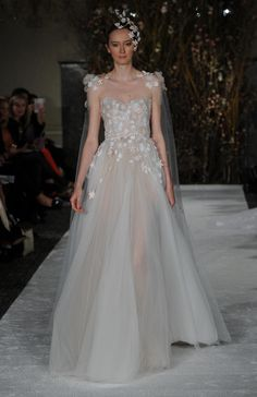 Sheer gown with floral appliques and matching veil | Mira Zwillinger Spring 2017 | https://www.theknot.com/content/mira-zwillinger-wedding-dresses-bridal-fashion-week-spring-2017