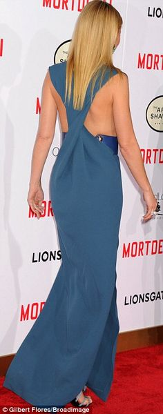 Showing off: The revealing cross back dress featured a blue leather belt around the torso...