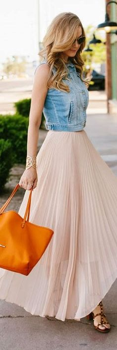 Love this jean vest with the long, pleated skirt.