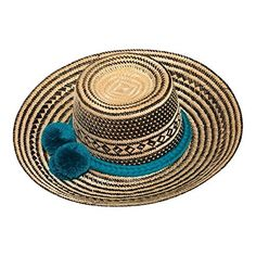 Discover the wonders of the skilled Wayuu Tribe traditions with this gorgeous hand woven, straw hat made in the Guajira region of Colombia. Get some shade or look perfectly accessorized while on vacation at the beach, this summer the Wayuu Hat in natural is all the...