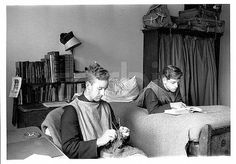 ca. 1950 --- The Society of the Sacred Mission - students relaxing in their room. --- Image by ? Hulton-Deutsch Collection/CORBIS