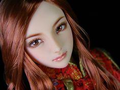 Obitsu custom doll with carved eyes.