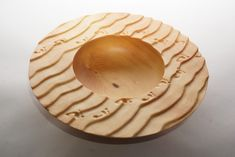 Simon Begg, footprints in the sand. My latest footprints in the sand bowls #woodturning #carving #footprintsinthesand #footprints #dogfootprints #huon #art
