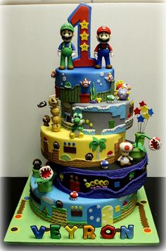 Mario Bros Cakes Its the first time i make 5 tiered cake, n its really challenging me to do it.but i'm happy how it turn out to be Mario Birthday Cake, Super Mario Birthday, Super Mario Party, Bolo Do Mario, Bolo Super Mario, Luigi Cake, Mario Bros Cake, Mario Kart Cake, Super Mario Bros