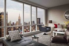 Apartments. Luxury New York Penthouse Inspiration. Admirable New York Penthouse Inspiration With Brown Sofa And Dark Brown Blue Armchairs And Black Sofa Bed Along With Red Black Throw Pillows And Also Dark Brown Floor Lamp And Yellow Orchids On White Coffee Table Also Cream Wall And Also Glass Windows And White Window Frames. Luxury New York Penthouses