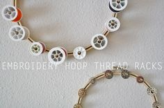 embroidery hoop thread racks  this is the craftiest thing ever!!! this one wins hands down..one for spools, bobbins, tools, pins..wow!! I love her!