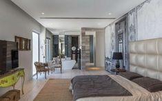 Diseño de dormitorio principal con cuarto de baño