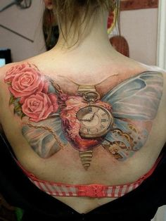 Back tattoo-Pretty:-) Love the Pocketwatch:-)