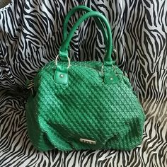 Steve Madden soft leather purse, almost new! Bright Kelly green Steve Madden purse with an additional long strap. This is so pretty and soft.  Purse has a bright yellow interior with gold hardware. Steve Madden Bags Satchels