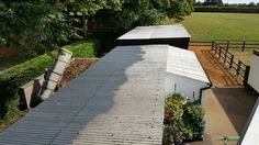 Asbestos Stable roof half coated with watertight coating #asbestos #stableroof #horse #stables