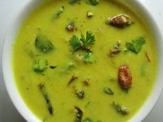 Moor Kuzhambu, a gravy made from buttermilk and ground coconut. Any desired vegetable can be used and served with hot rice.