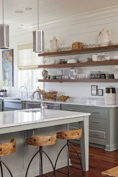 wood open shelving, white counters, gray cabinets, planked walls