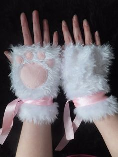 Hey, I found this really awesome Etsy listing at http://www.etsy.com/listing/124192259/cute-white-pink-furry-cat-paw-fingerless