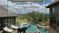 Take a cooling soak in your private watering hole as you watch elephants play in theirs at Four Seasons Safari Lodge Serengeti, Tanzania.