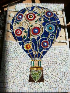 Muni's Mosaics: I love the intricacy of this design! Obviously a very patient & talented artist!Mosaic hot air balloon for JuneLike the use of monotone patterns for background Mosaic Crafts, Mosaic Projects, Stained Glass Projects, Stained Glass Art, Mosaic Glass, Mosaic Madness, Mosaic Designs, Mosaic Patterns, Mosaic Wall Art