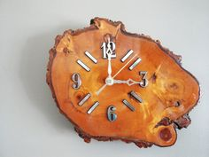 Wood clock  http://www.etsy.com/listing/129940918/vintage-wooden-clock-burl-wood-slab