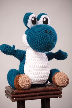 Yoshi - from Super Mario Bross Game - Free Amigurumi Pattern here: http://robotrish.com/2010/05/02/free-amigurumi-yoshi-pattern/  and here the Adjustments: http://the-hook-brings-you-back.blogspot.com.ar/2011/06/yoshi.html?showComment=1307502744859