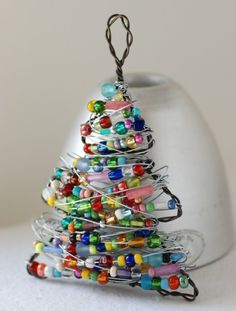 For the crafty.  Looks like a wire hanger, craft wire and beads.  Very cute #DIY Christmas