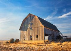 An old empty barn at sunset...