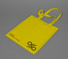 Yellow tote bag for banking systems and solutions firm Crosskey designed by Kurppa Hosk. #Bag #Design #Branding
