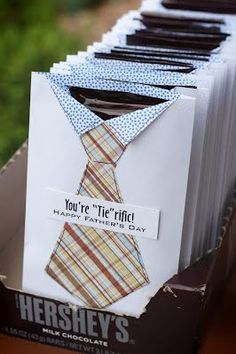 """Cute. Seal a regular envelope, cut off one side. Find center of the cut end, snip down 1"""" and fold back to form collar of white """"shirt"""". Cut out tie shape from patterned paper and attach to shirt along with the message. Insert Hershey bar."""
