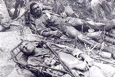 "Two wounded Marines from ""I"" company 7th Marines await evacuation by Helicopter. The Marines engaged the NVA South of the Demilitarized Zone. AP Wire photo 1966"