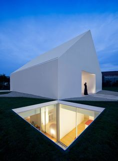 A white minimalistic house by Manuel Aires Mateus in the outskirts of Leiria ,Portugal.This ethereal white house acts as a mystical object in its environme