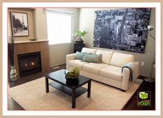 After Home Staging: This living room is now bright, fresh and has a spark of colour. The fireplace is lit to add some coziness to the room.