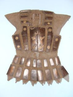 Moro (Philippine, Mindanao) mail and plate armor, 19th century, brass, carabao horn (Philippine buffalo), silver, protection for the upper part of the body, exclusive to the Moro as it was not found among any other Philippine groups. This armor known as kurab-a-kulang is made of a thin layer of carabao horn joined with butted brass mail the front part is closed with hooks.