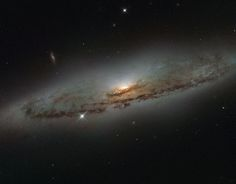 This NASA/ESA Hubble Space Telescope image shows the spiral galaxy NGC 4845, located over 65 million light-years away in the constellation of Virgo (The Virgin). The galaxy's orientation clearly reveals the galaxy's striking spiral structure: a flat and dust-mottled disk surrounding a bright galactic bulge.