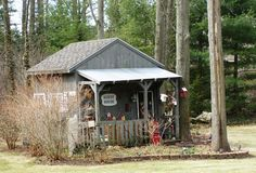 Shed with lots of curb appeal spotted in Grand Haven, Michigan.....love the porch with the tin roof.