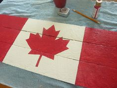 Canada Flag Pallet Sign - The Happy Housie Pallet Flag, Pallet Signs, Canada Day Fireworks, Rock Climbing Gear, Happy Canada Day, National Holidays, Pallet Creations, Cottage Design, Painting On Wood