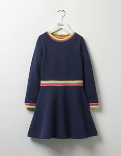 What's at the end of the rainbow? It looks like it's you, wearing this relaxed jersey dress with a pretty multi-coloured stripe at the cuffs, neck and waist. This A-line style is fun to wear, with brushback fabric and long sleeves to keep off the breezes.