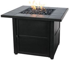 A slate tile finish is the highlight of this gas burning fire pit. 31 wide x 31 deep x 24 high. Liquid petroleum propane gas outdoor fire pit table (gas tank not included). Style # at Lamps Plus.