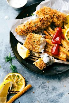 ONE PAN easy baked fish and chips -- the crispiest baked fries you'll ever eat and delicious fish! Simple prep.