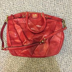 Red Coach Purse patent bag with elbow strap and longer removable shoulder strap, top zip closure, gold hardware, some wear on the back and on the shorter straps, grey lining with zipped pocket and cell phone pocket and larger pocket. Coach Bags Shoulder Bags