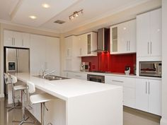 Modern island kitchen design using glass