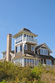 Grey shingle style beach house with lookout tower and white framed windows. This style is common throughout the East Coast of the United States (although this example is a particularly nice shingle style home) Beach Cottage Style, Beach House Decor, Home Decor, Shingle Style Homes, Shingle Style Architecture, Classical Architecture, Lookout Tower, Tower House, World Photo