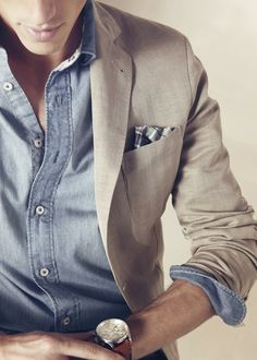 Denim button up shirt with khaki jacket and pocket square